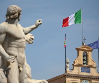 FILE PHOTO: The Italian flag waves over the Quirinal Palace in Rome