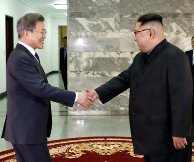 South Korean President Moon Jae-in is greeted by North Korean leader Kim Jong Un during their summit at the truce village of Panmunjom