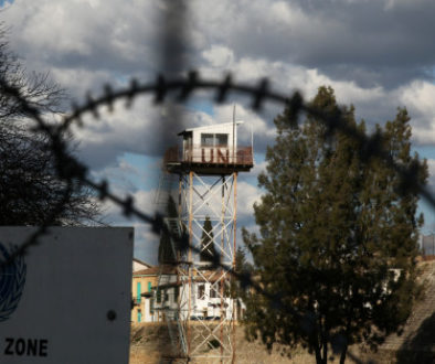 An abandoned UN outpost is seen behind the barbed wire inside the UN-controlled buffer zone in Nicosia