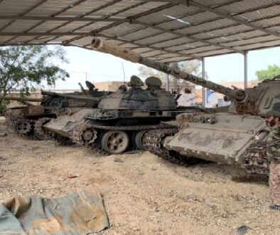 Fighter loyal to Libya's internationally recognised government is seen near confiscated tanks after regaining control over Tripoli