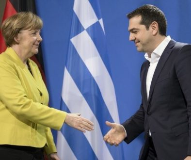German Chancellor Merkel and Greek Prime Minister Tsipras go to shake hands after addressing news conference in Berlin